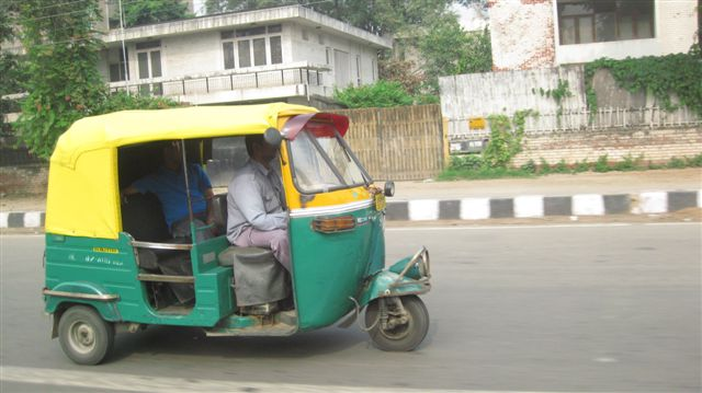 Tuk Tuk - Or Auto Rickshaw. They run on Natural Gas! The cleanest thing in India
