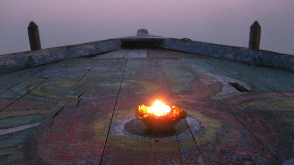 We crawled into boats on the Ganges to watch the morning prayers.