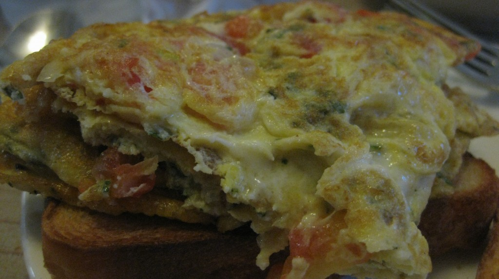 Our usual breakfast. Masala omelette! They're egg yolks look like egg whites. Hmm...