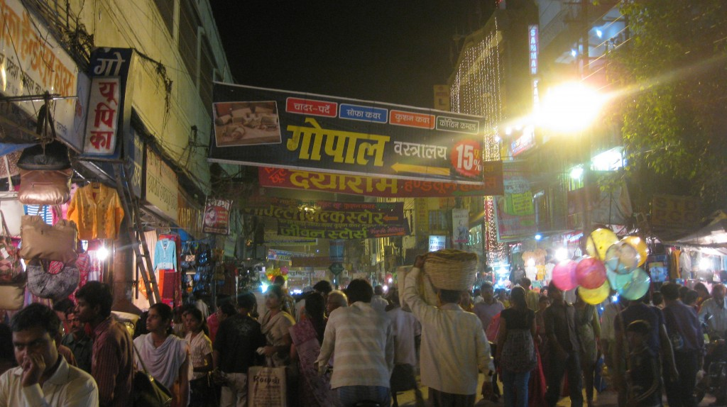 Walking to the Ganges for the nighttime prayer ceremony. Weren't we just here? The craziest street on the planet.