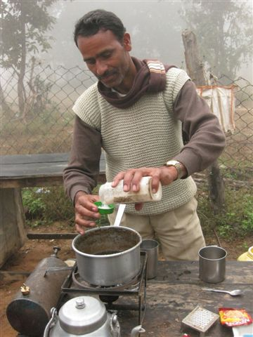 Taking a break from our safar, a man makes the tastiest Masala tea with fresh ginger and spices.