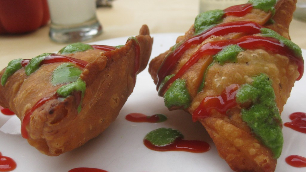 The Samosa. The world's perfect food. I don't care what's inside. It's fried. And I covered it in ketchup and some green shit.