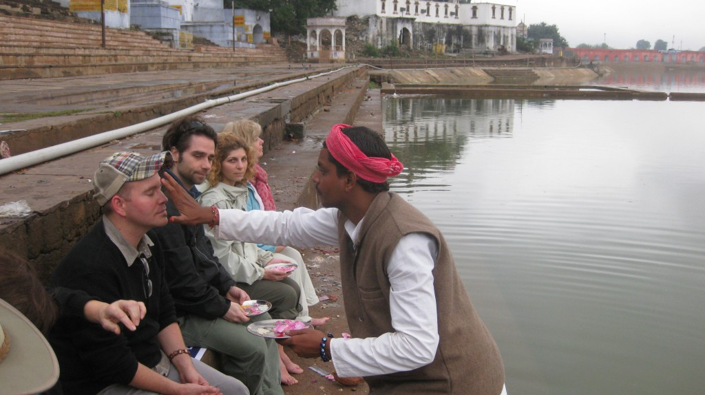 A prayer ceremony with a holy man in the holy city of Pushkar. God knows what he's wiping on my forehead...