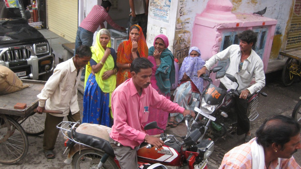 Our convoy was in a traffic jam and this bewildered and bewitched the colorful onlookers.