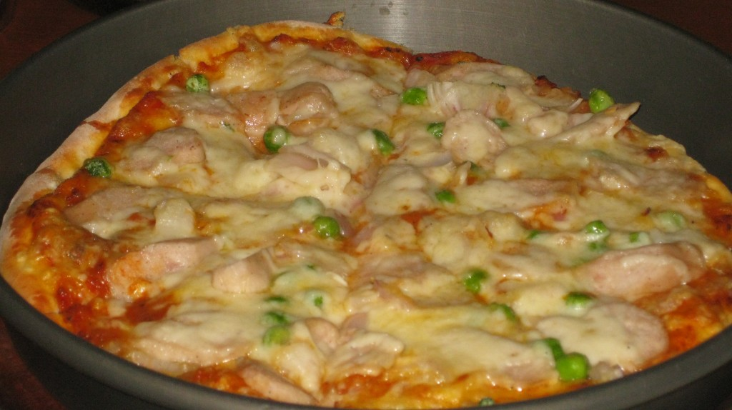 Indian Pizza with peas and some questionable white sausage. Our farewell dinner with our tour group.