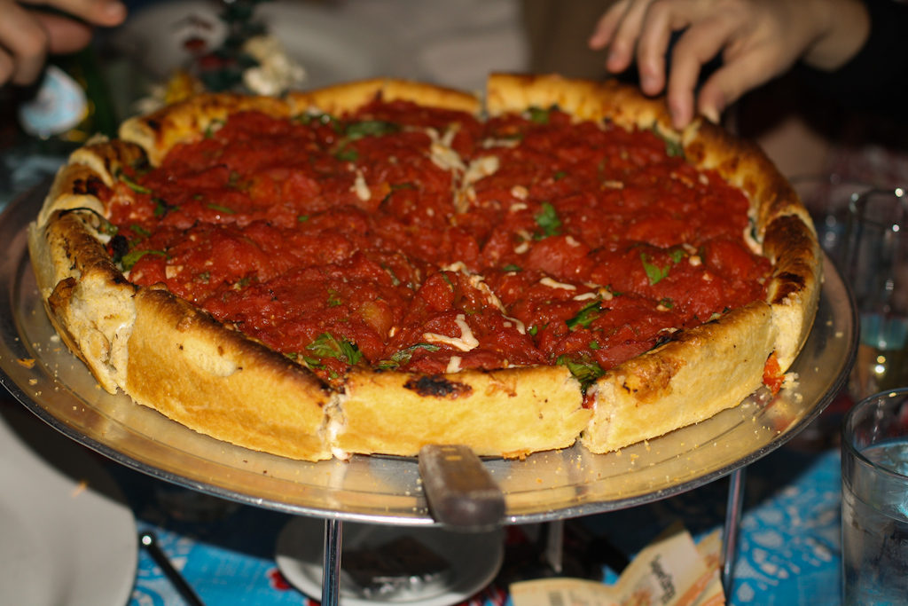 Vegan Chicago Deep Dish with Soy Cheese (with grubby little paws greedily picking at it)