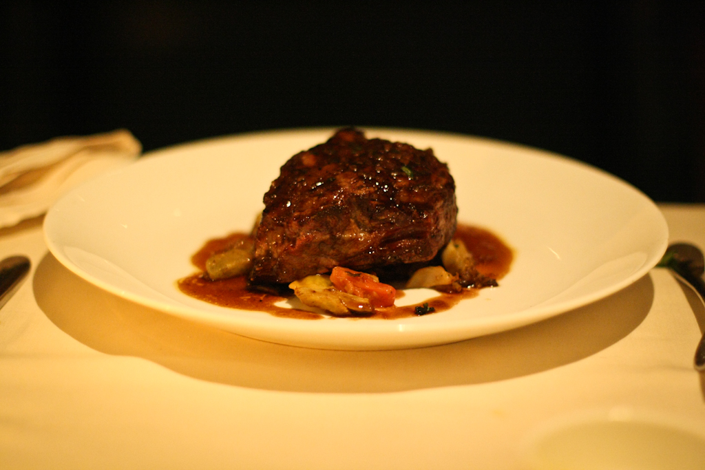 NATURAL BEEF RIBEYE artichoke heart, blistered tomato, caramelized sunchoke, bordelaise