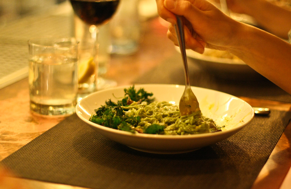 Taglioni al'Ortica - hand-cut stinging nettle pasta, mushroom ragu, poached farm egg, fried nettles