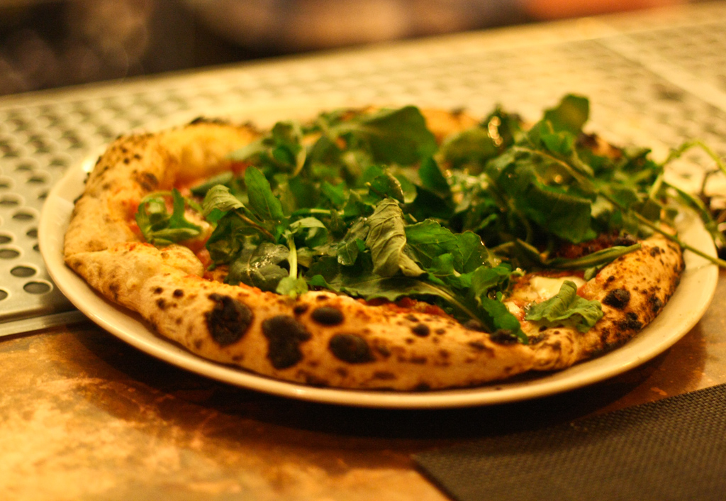 Pizza Alla'nduja - housemade spicy 'nduja (spreadable salami) san marzano tomatoes, mozarella, wild arugula