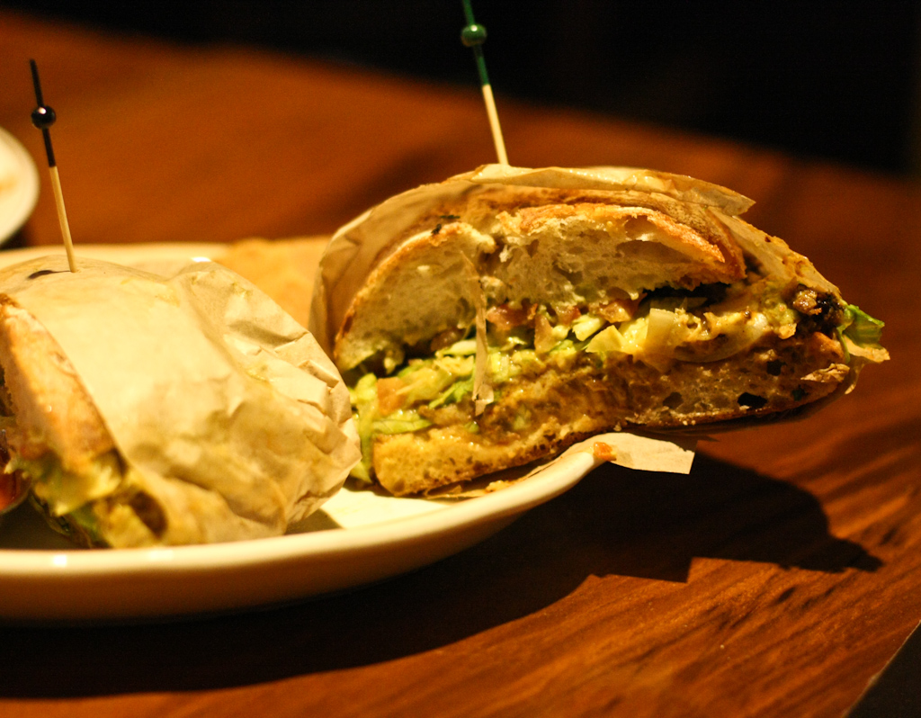 TIA TORTA - Lone Mountain Wagyu ground beef, dill pickles, mustard, refried beans, lettuce and shredded cheddar