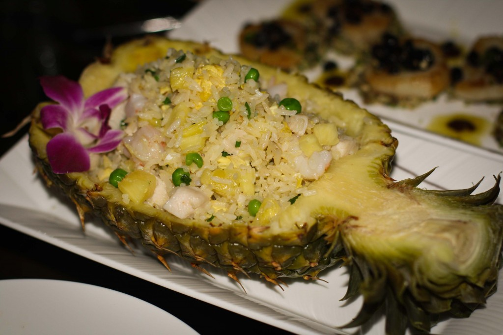 HONG KONG PINEAPPLE RICE 菠蘿炒飯 WOK TOSSED RICE WITH FRESH PINEAPPLE, SHRIMP, CHICKEN, PEAS AND CARROTS BAKED IN A HOLLOWED PINEAPPLE 16