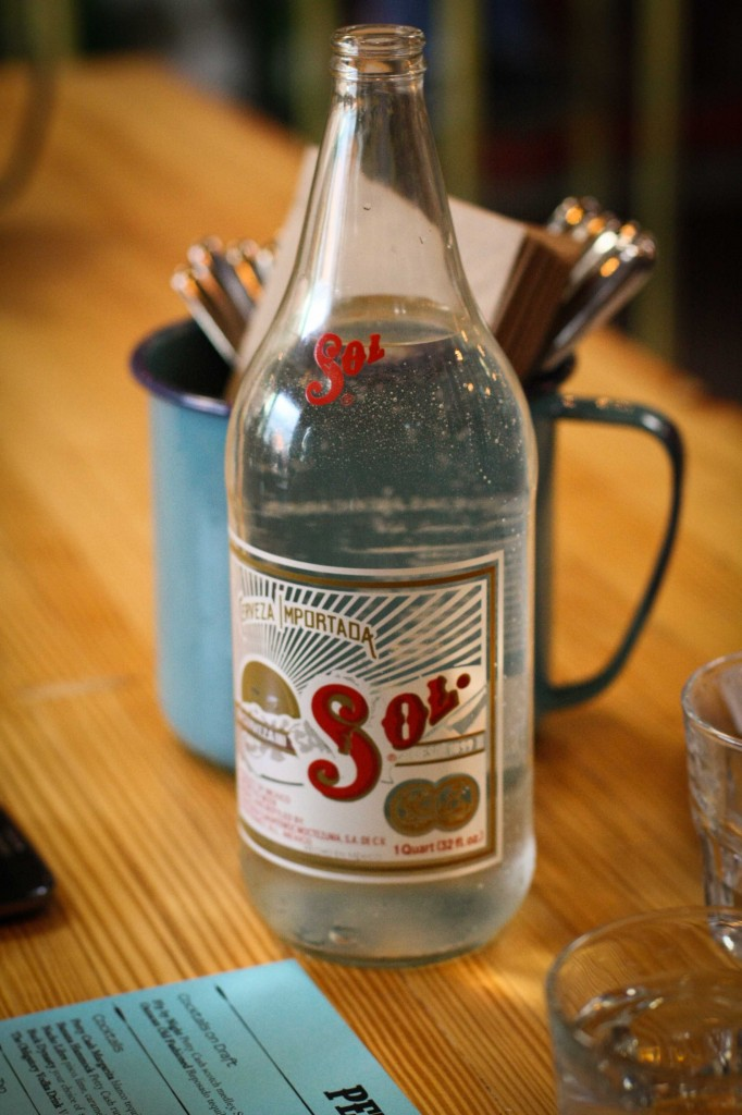 Water for the table in old beer bottles.