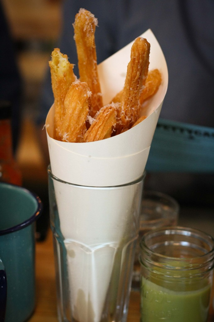 Cheesy Churros with green mole-corn dip
