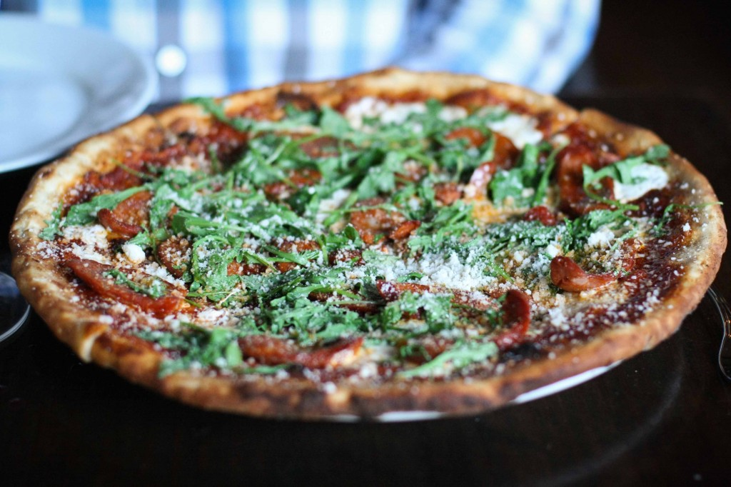 Wood Fired Pizza - traditional tomato sauce + cheese pie with linguica + wild arugula