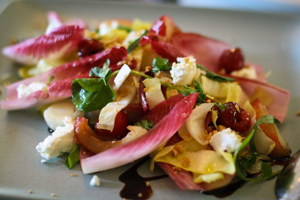 Watercress and Endive Salad with peaches, almonds, cherries and goat cheese.