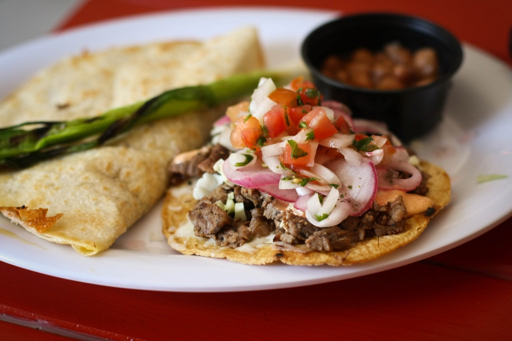 Carne Asada Cachetada - Tostada with beef, Mexican cheese and chipotle aioli