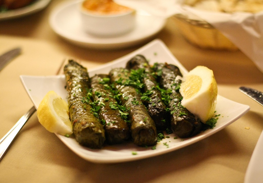 Vegetarian Grape Leaves - A mixture of rice, finely diced tomato, parsley, onion rolled in grape leaves and slowly cooked in extra virgin olive oil and fresh lemon juice.