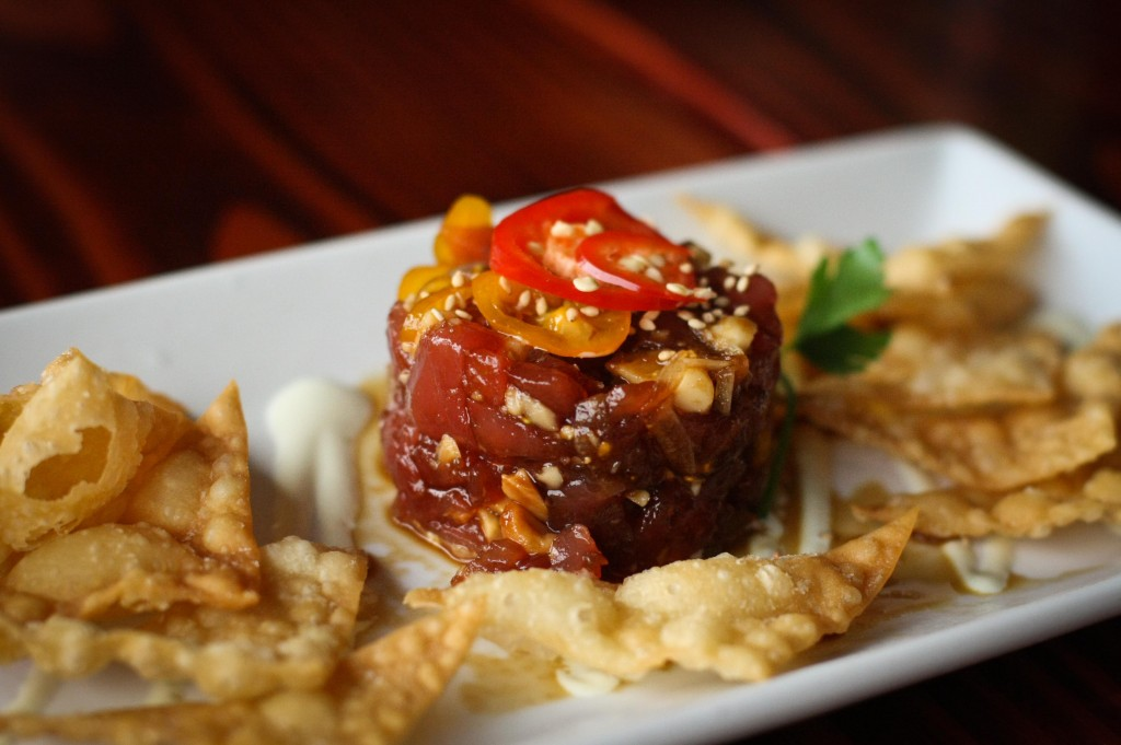 Ahi Poke - Tomato, Macadamia nuts, Onion, Soy-Sesame marinade, Wasabi Aioli