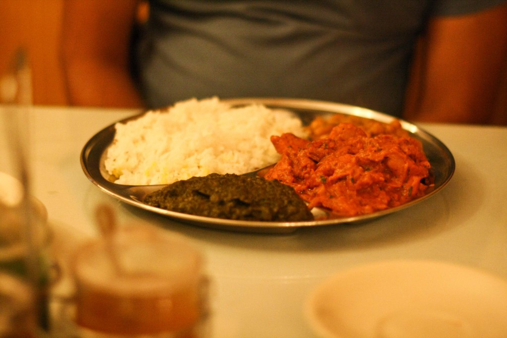 Chicken Vindaloo with rice, saag and chana masala.