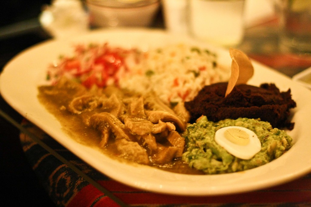TIRAS DE RES Beef belly in a mild green tomato sauce served with radish salad, guacamole and rice