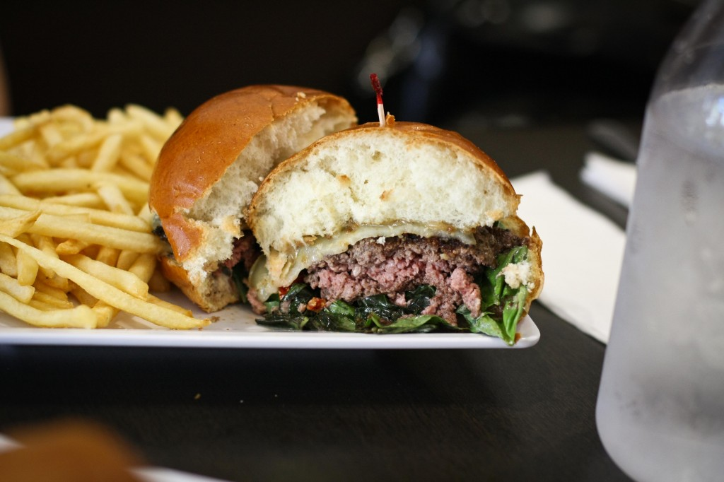 the BRUSHETTA the burger that will have you saying grande mangia! with marinated balsamic vinegar tomatoes, basil leaves, mozzarella and parmesan cheeses and our roasted garlic aioli