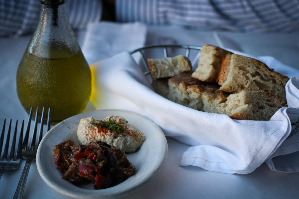 Bread basket with hummus and eggplant caponata