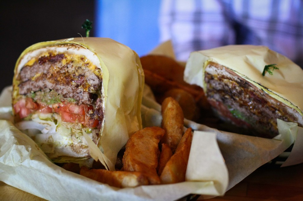 This is ONE burger, cut in half. Do not attempt to eat a whole one by yourself.