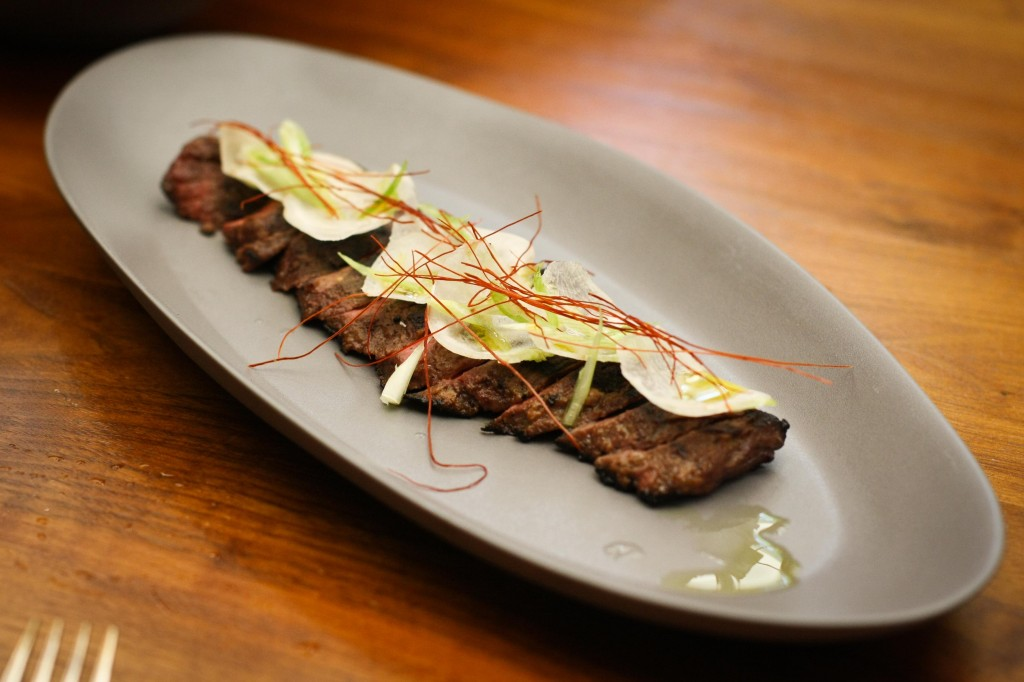 Miso marinated Skirt Steak, shaved turnips, chili