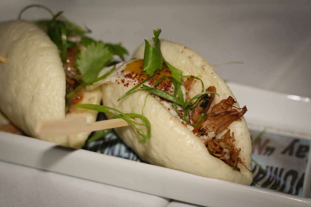STEAMED BUNS / crispy duck confit / spicy daikon-scallion relish / pickled stone fruit