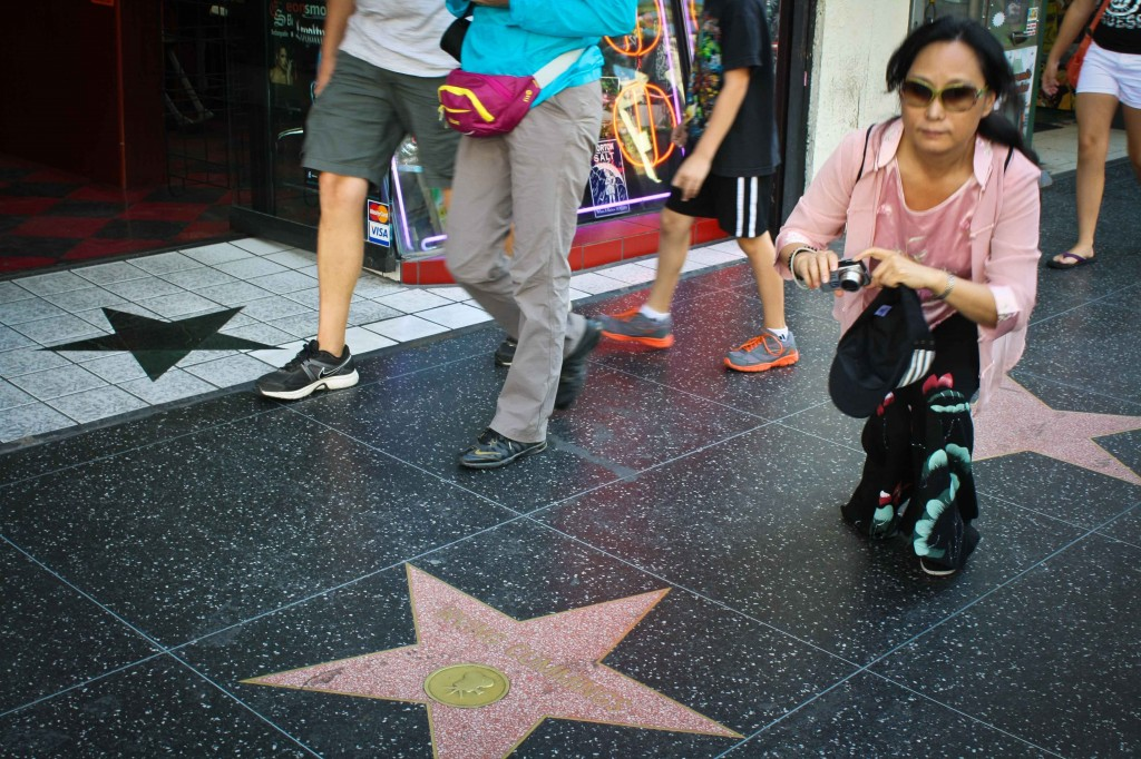 In Hollywood, tourists enjoy snapping photos of the sidewalk for some reason.