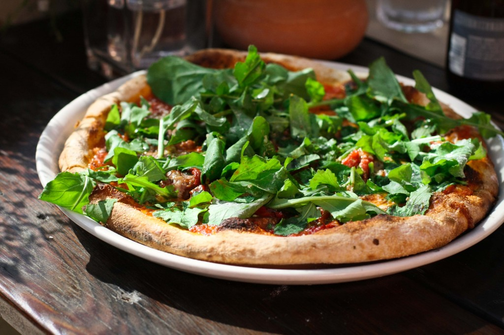 Diavola Pizza - Roasted Red Peppers, Provolone, Arugula & House Meatballs with pine nuts and raisins