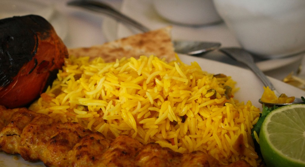 Shirin Polo - Orange peels, pistachios, almonds, saffron and rosewater mixed with rice.
