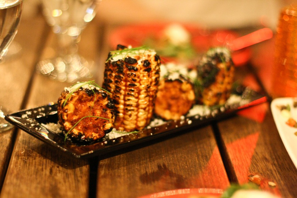 Maize Negro – 6 charred white corncobs marinated in house spices then finished with cotija cheese & crispy parsley