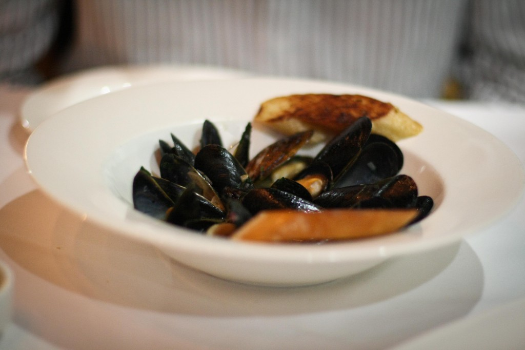 Steamed mussels with fresh Seville orange and lim juice, white wine and garlic with grilled bread