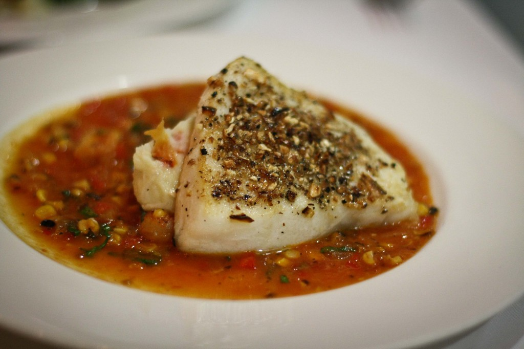Chilean sea bass with a crispy corn crust served on roasted bell pepper, mashed potatoes and corn stew