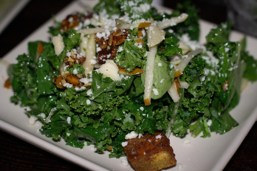 Mexican Kale Salad – kale, arugula, candied pumpkin seeds, pears, dried strawberries, cotija-pesto croutons, agave-lime vinaigrette