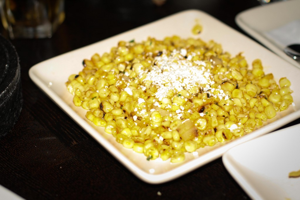 Elote Callejero – grilled sweet corn, caramelized onions, chile piquin butter, queso cotija