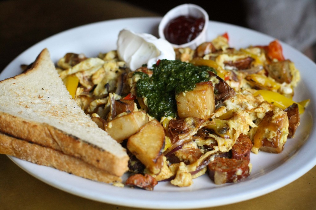 Hangover -  Scrambled eggs, chicken andouille sausage, grilled peppers, fried potatoes, cheddar & jack cheese, green onions, habanero pesto, sour cream, toast