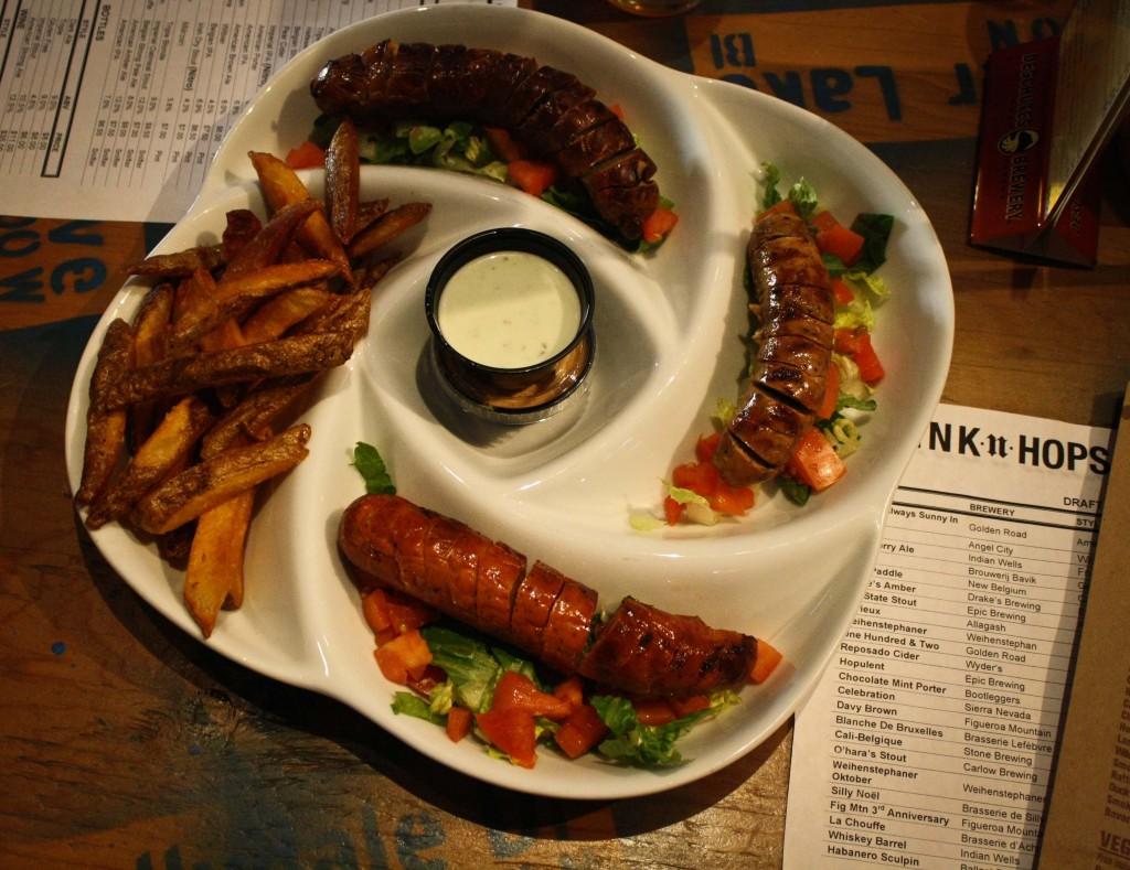 Traditional Platter: Bratwurst, Hungarian Kolbasa, Smoked Anduille, Belgian Fries