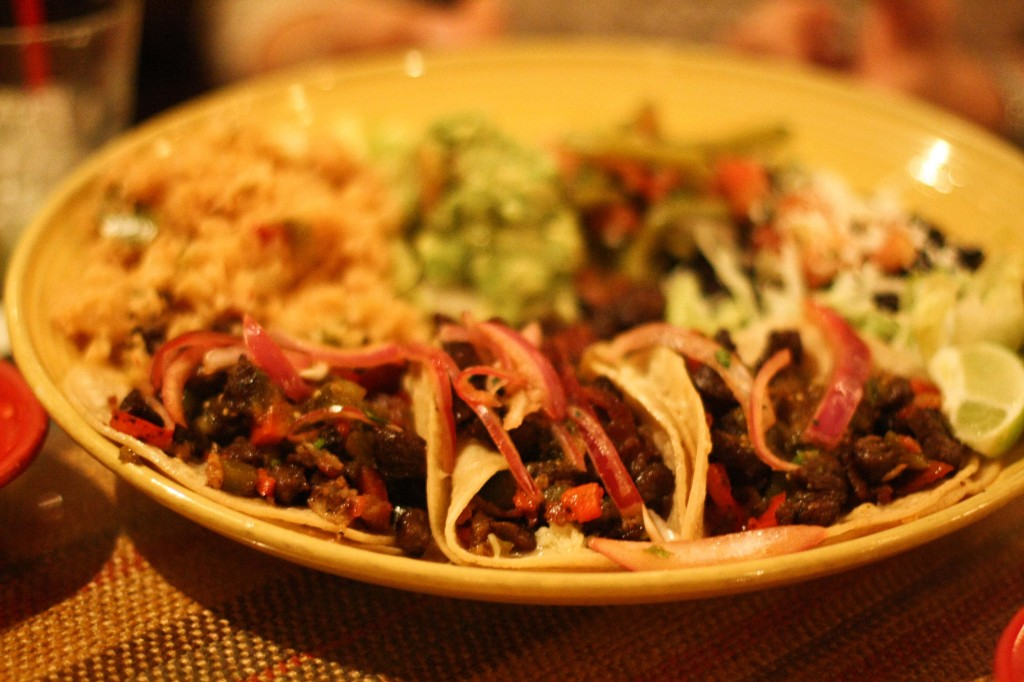 Tres Tacos al Carbon (1990)  Grilled Marinated Top Sirloin with Bacon, Jack Cheese, Tomatillo-Chipotle Salsa,Black Beans and Rice.