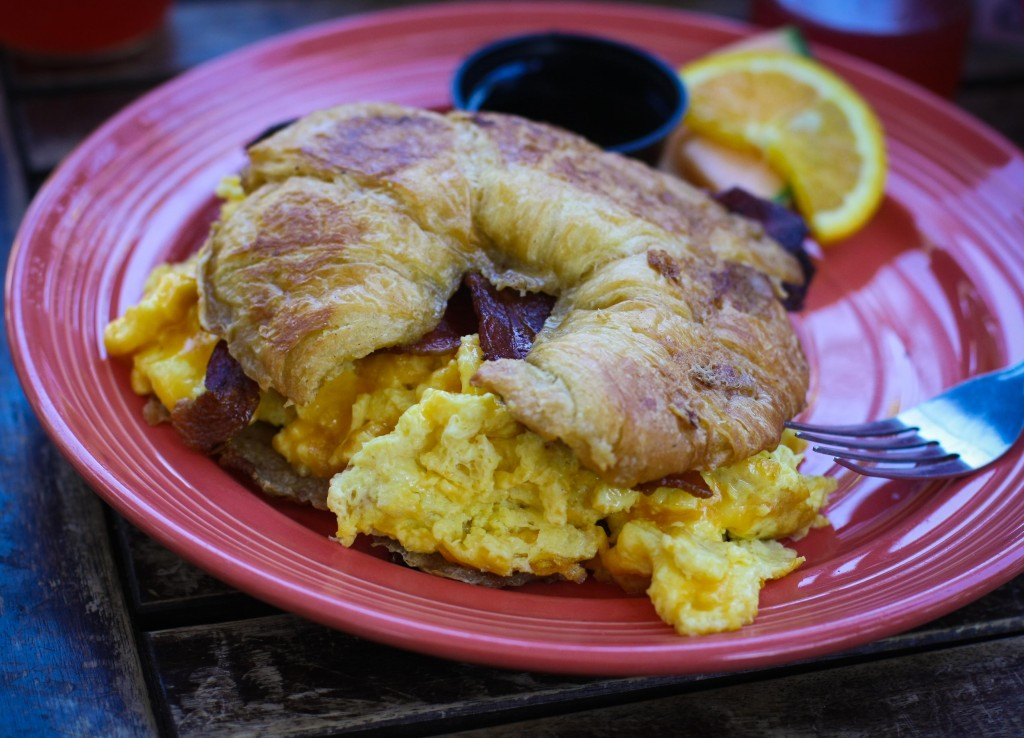 OOH LA LA! Egg Sandwich 13.99 Fluffy scrambled Eggs, gooey Cheddar Cheese, two slices of our Sweet & Sassy Bacon sandwiched between two slices of our Croissant French Toast, served with a side of Maple Syrup.