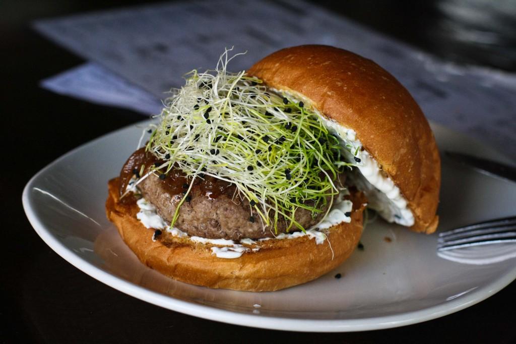 Lamb Burger - onion jam, tzatziki, onion sprouts, rosemary brioche bun
