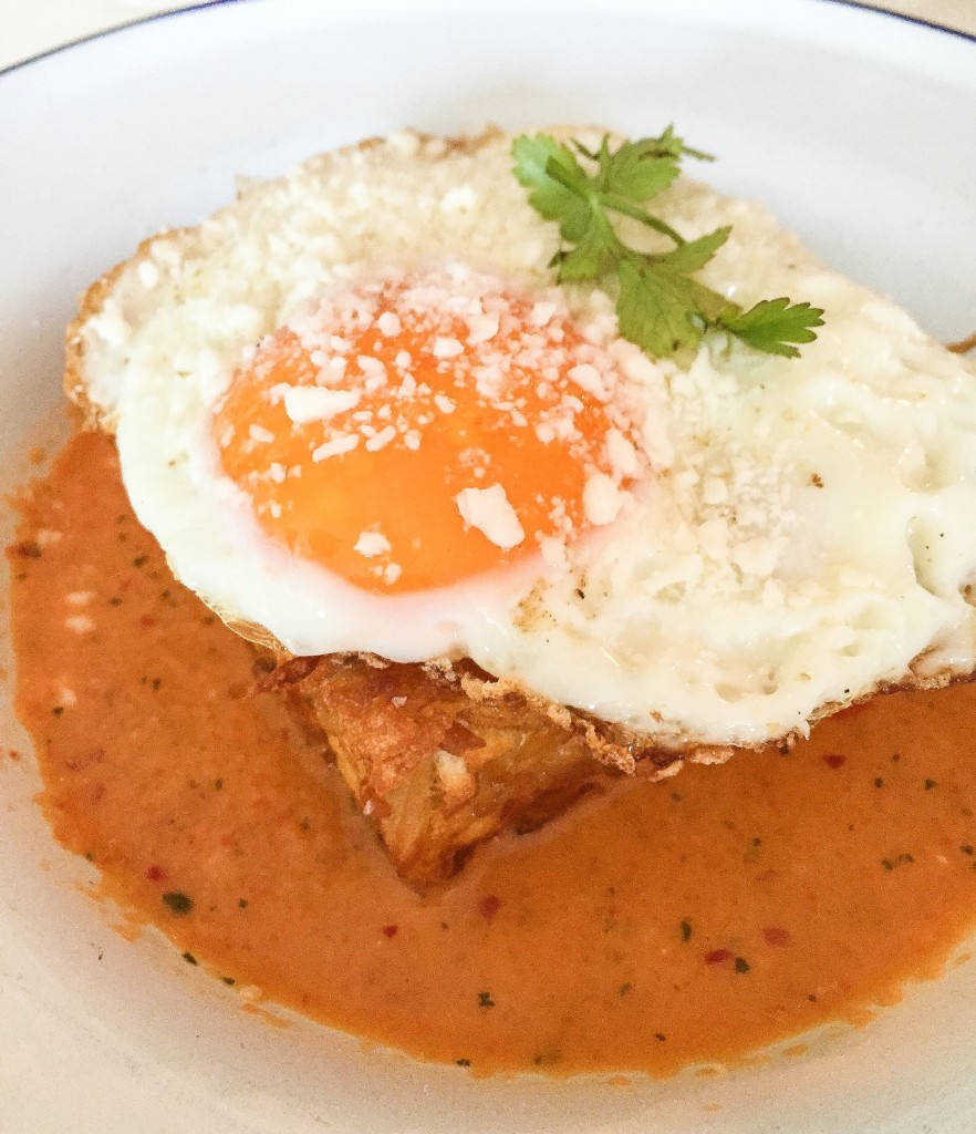 Crispy Hash Brown Chilaquiles, sunny side up egg, cotija, salsa macho - $10.25